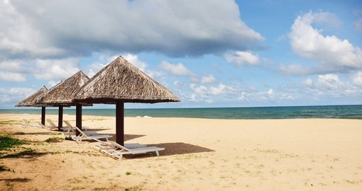 Hut, umbrella and deck chairs on the sandy beaches of Phu Quoc