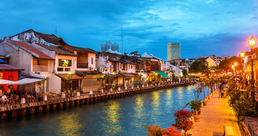 Embrace the local way of life by walking down the Malacca River on your Malaysian Vacation
