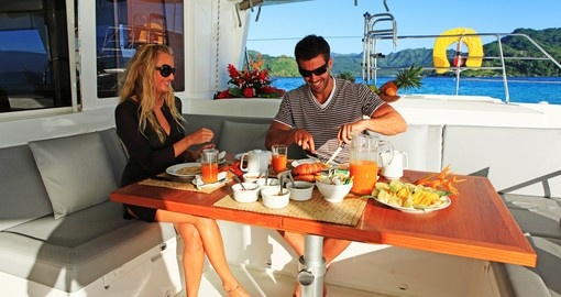 Enjoy traditional breakfast on board during your catamaran ride during your next trip to Bora Bora.