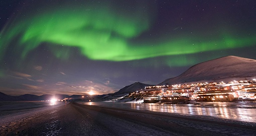 The polar aurora Northern lights in the mountains near Spitsbergen