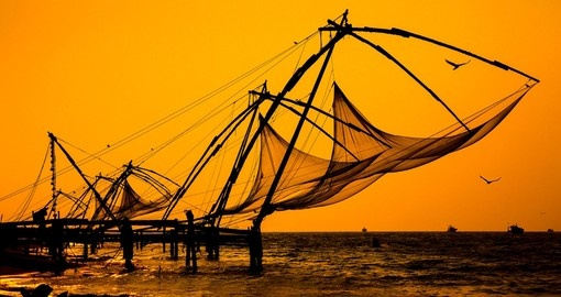 You will be able to see fisherman use Chinese style fishnets on your next India tours.