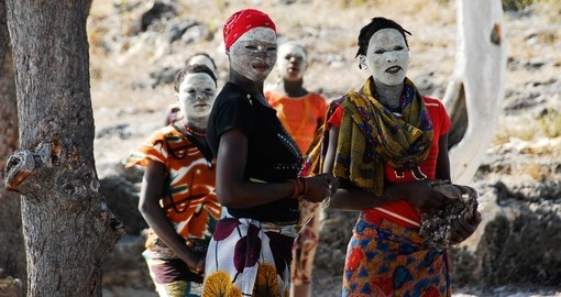Makua women with traditional white face mask