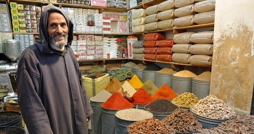 A spice seller in the medina of Fez makes for a great photo opportunity on all Morocco vacations.