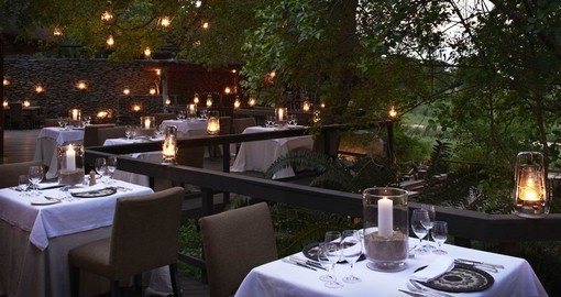 Enjoy amazing dinner outdoors at your stay at Boulders lodge during your next South Africa tours.