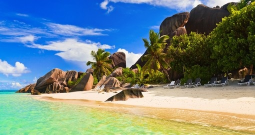 Relax on a tropical beach on your Seychelles vacation.