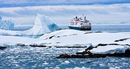 Big cruise ship in the waters of Antarctic