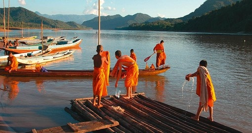 Observe Monks working on the Mekong River during your Laos vacation