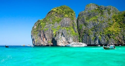 Swim in bright blue water on Phi Phi Island  during your Thailand Tour
