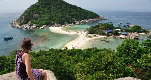 Traveller over looking Koh Tao island in the South of Thailand.