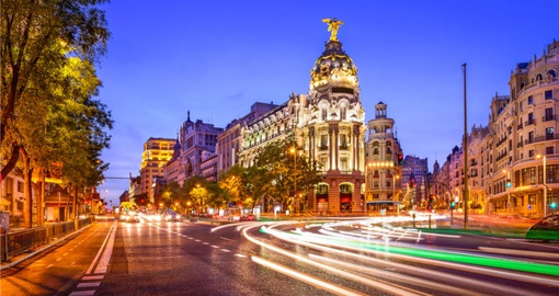 Stroll the bustling Gran Via in Madrid on your Spain Tour