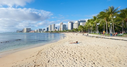 Visit Waikiki Beach in Honolulu during your Hawaii vacation.