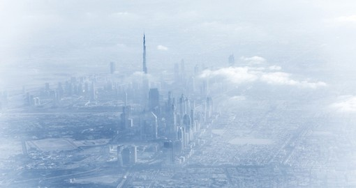 Dubai downtown in fog, beautiful misty cityscape