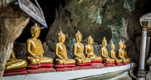 Take a boat ride to a small town where the Pak Ou Caves are located and where you can find a large array of Buddhist statues on your Laos Vacation