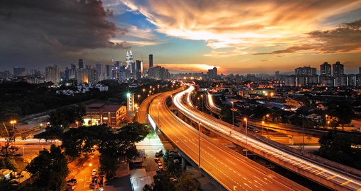 Enjoy the skyline of Kuala Lumpur that lights up during the night time on your Malaysia Vacation