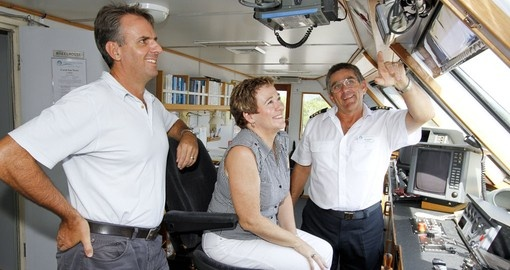 Touring the bridge of the Coral Expeditions I
