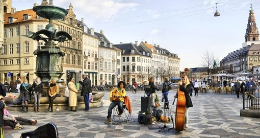 Listen to street musicians near the Stork Fountain on your Copenhagen Tour