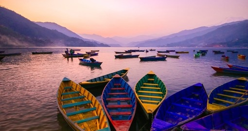 Coast along the calm waters of Phewa Lake in Pokhara and enjoy beautiful mountain landscapes on one of your Nepal Tours