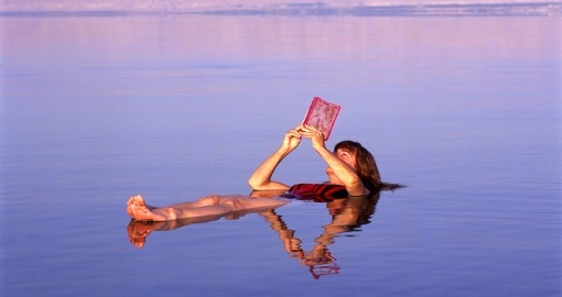 Floating in the Dead Sea makes for some great photos while on your Jordan vacation.