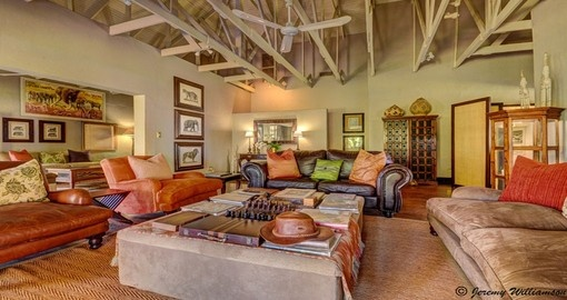 Lounge in comfort at the White Elephant Safari Lodge during your South Africa trip.