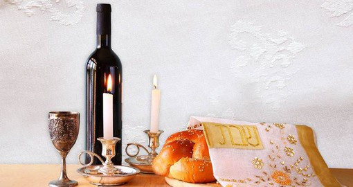 Shabbat foods include challah (braided bread) and wine, which are both blessed