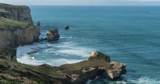 See beautiful Tunnel Beach on the Otago Peninsula during your New Zealand Vacation
