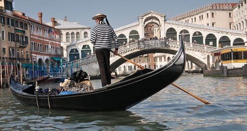 Gondolier near Rialto Bridge on the Grand Canal