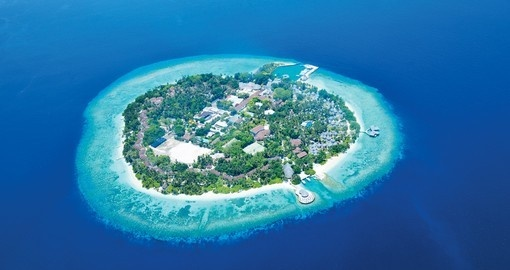 Experience true seclusion on this private island resort that is included on your Maldives Vacation Packages