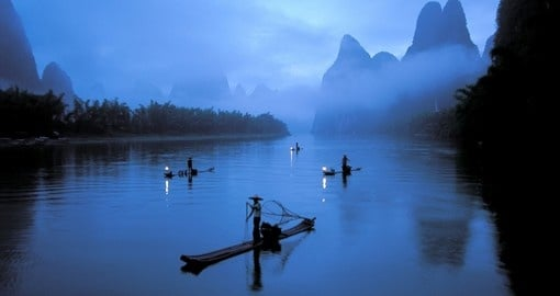 Watch fishermen on the river on your trip to China
