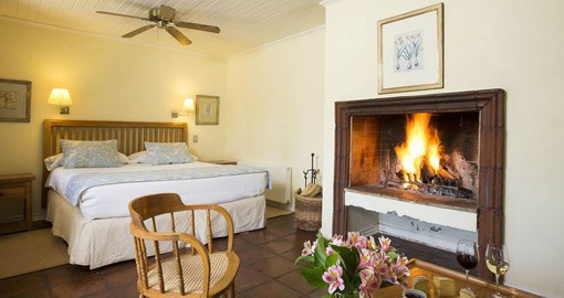 The rooms feature a fireplace with splendid views of the gardens