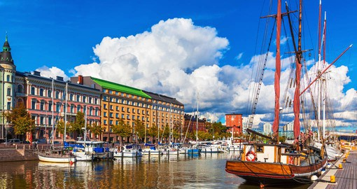 Helsinki  is a vibrant seaside city of beautiful islands and great green urban areas