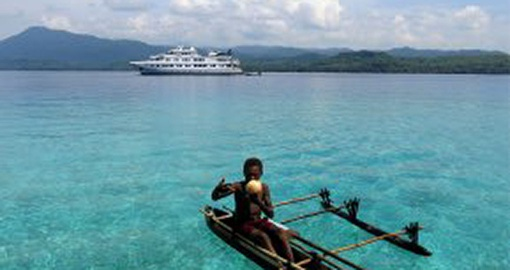 Experience traditional boat ride on your next trip to Papua New Guinea.