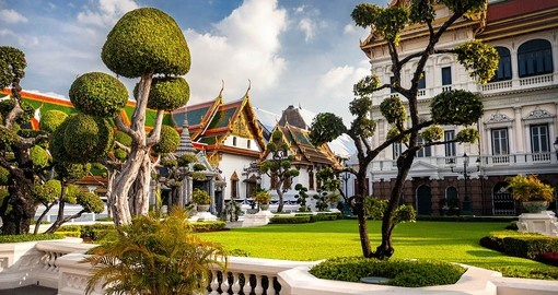 Wander around the gardens of the Grand Palace in Bangkok on your Thailand Tours.