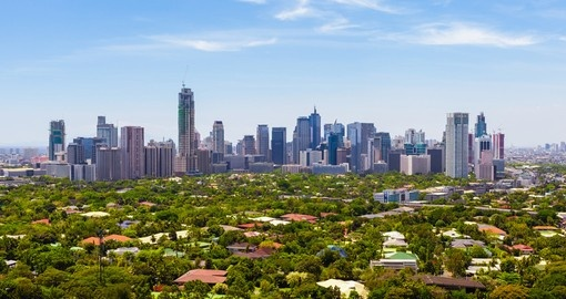 Sit back on the hillside and gaze into the distance on the Manila Skyline on your Trips to Philippines