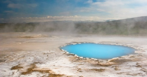 Visit the Geysir geothermal area with hot spring during your Iceland trip.