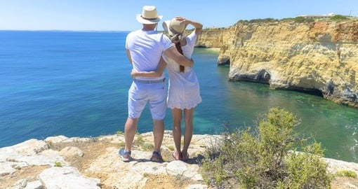 A couple enjoying the ocean view from Algarve