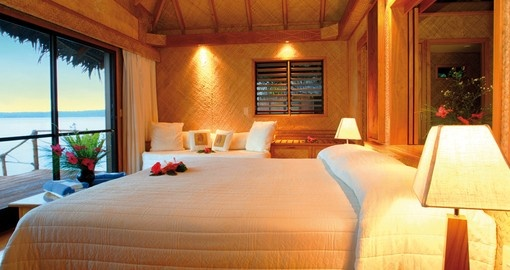 Relax at night in your own over water bundalow at the Aitutaki Lagoon Resort on a Cook Island Vacation Packages