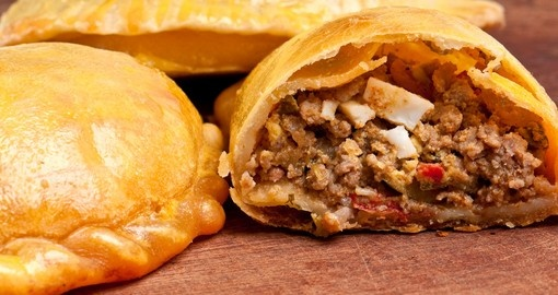 Empanada is a pastry turnover filled with_a variety of savory ingredients