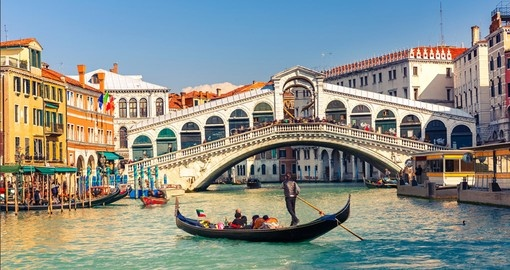 Take optional gondola rides in Venice during your next trip to Italy.