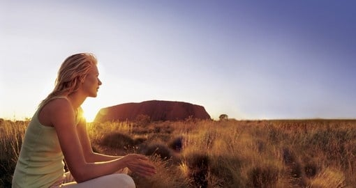 An amazing view of Uluru at sunset will leave with no words during your next Australia Vacations.