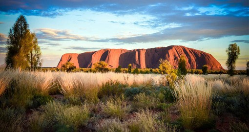 Experience the beauty of Uluru at dusk during your next Australia vacations.