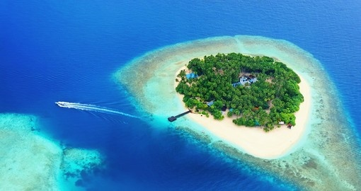 Rest on one of the small tropical islands that surround the Maldives on your Trip to Maldives