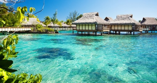 Overwater bungalows with an amazing green lagoon