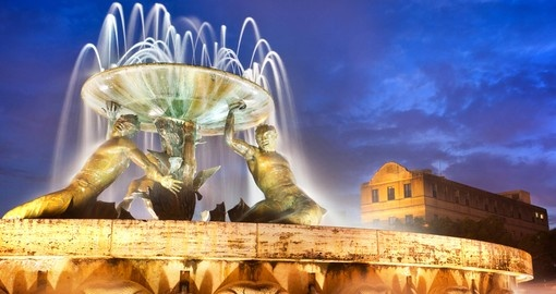 The Triton Fountain - always a popular photo stop on all Malta vacations.