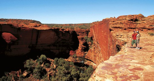 The crimson walls of Kings Canyon are over 100 metres high are an inspiring addition to your trip to Australia