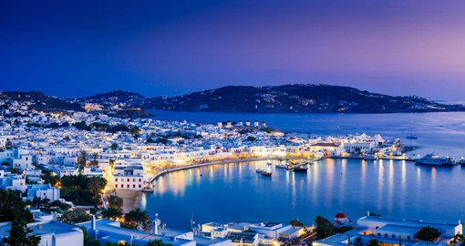 Travel to Mykonos at sunset on your Greece Vacation