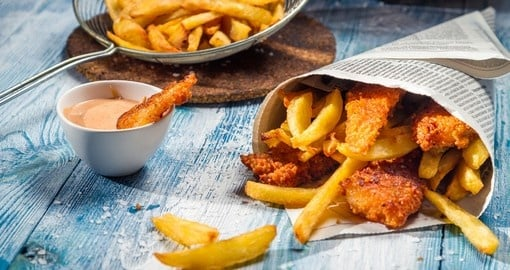 Fish and chips served in a newspaper - a great choice for a dinner on all Australia tours.
