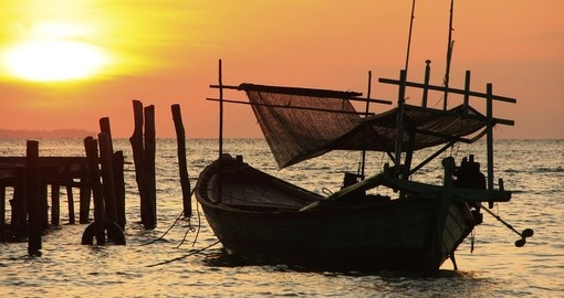 See traditional fishing boats on your Cambodia Tour