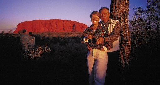 Stare up at the stars and gaze off into the distance at Uluru at night during your Australia Vacation