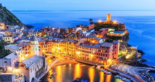 Experience twilight view of Vernazza village on your next Italy vacations.