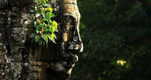 Marvel at the Bayon Faces on your trip to Cambodia